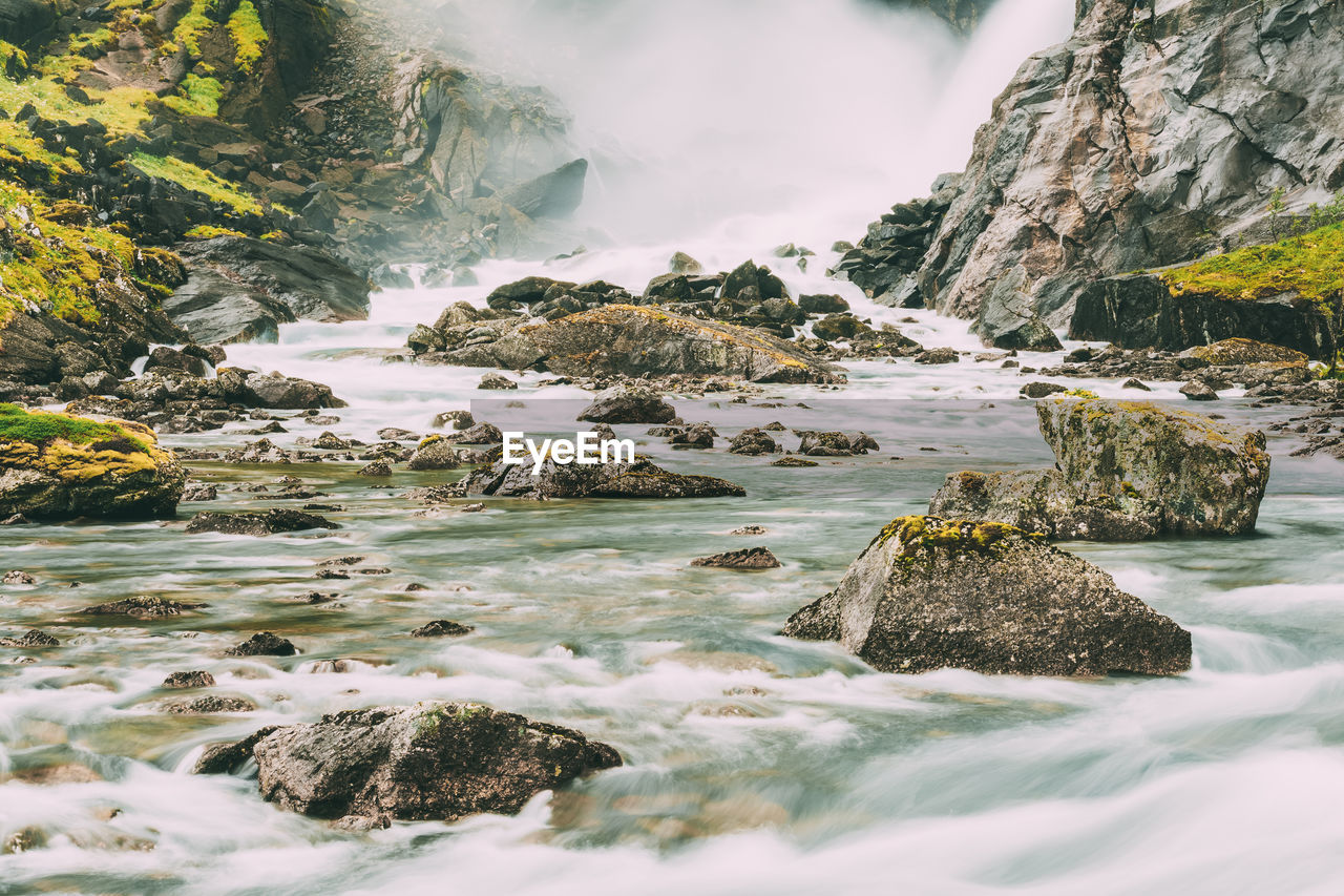 water, rock, solid, beauty in nature, rock - object, scenics - nature, nature, motion, no people, day, tranquility, sea, long exposure, flowing water, land, mountain, outdoors, rock formation, flowing
