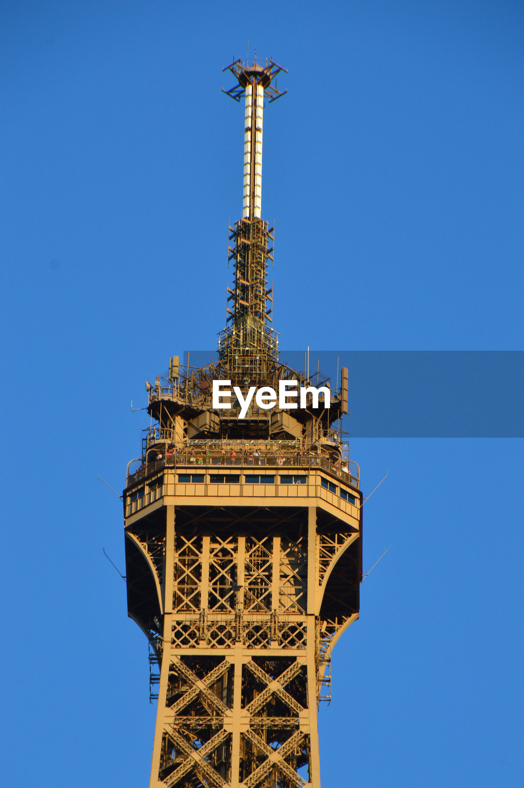 Low angle view of eiffel tower against blue sky.