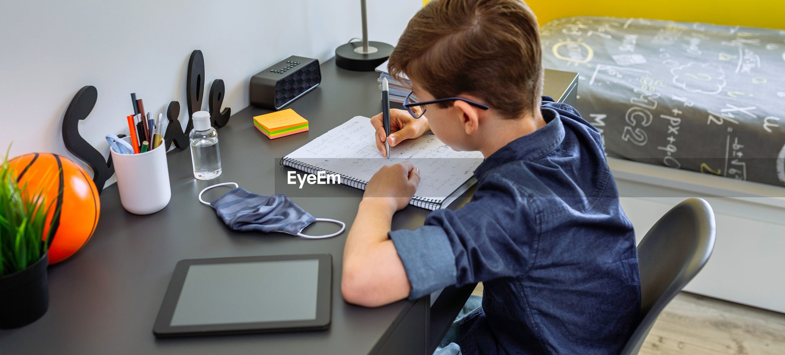 High angle view of boy studying at home