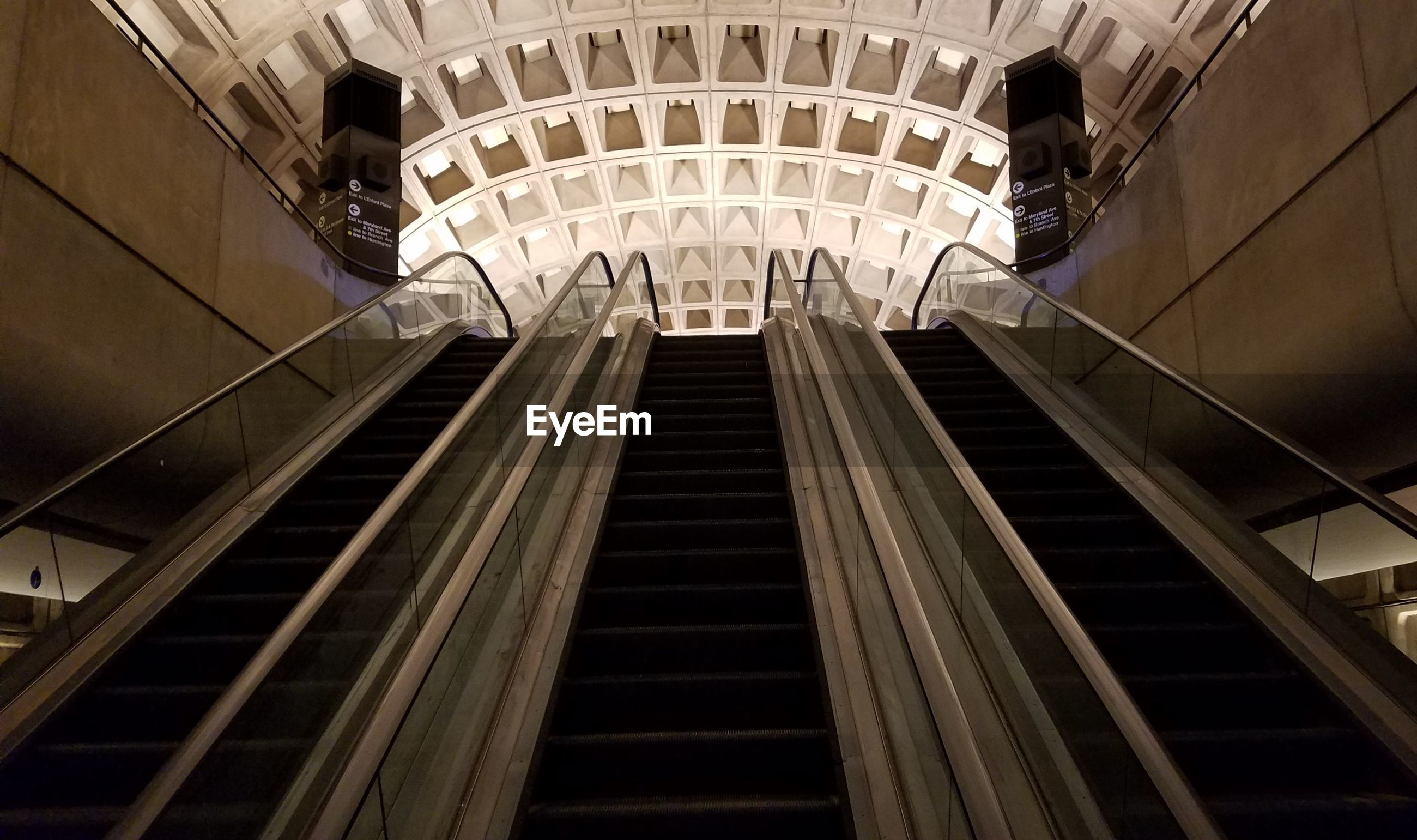 LOW ANGLE VIEW OF ESCALATOR IN CITY