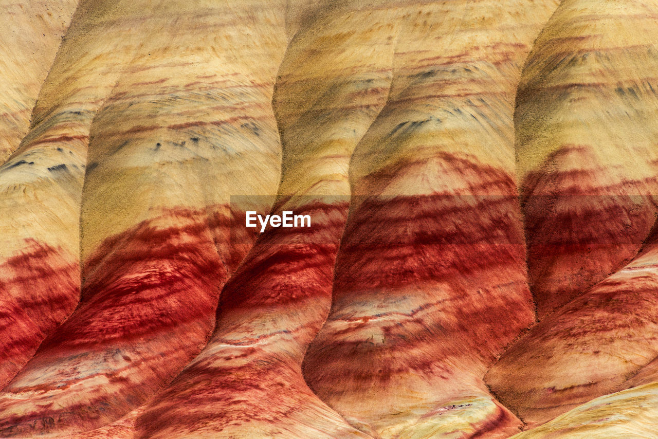 full frame, backgrounds, close-up, no people, pattern, indoors, multi colored, textured, day, nature, striped, beauty in nature, red, textile, wellbeing, natural pattern, food, side by side, rock