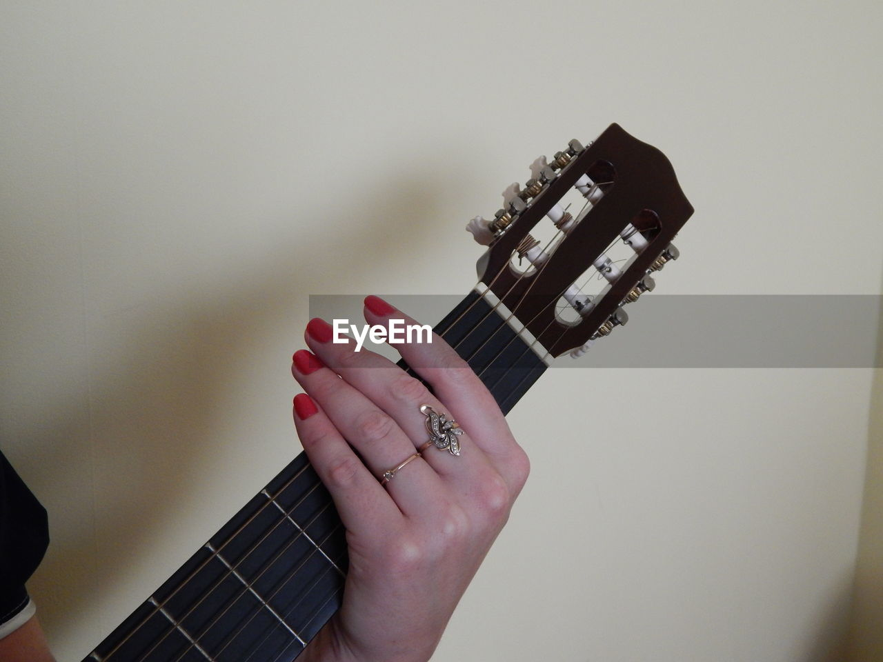 Cropped Hand Of Woman Playing Guitar