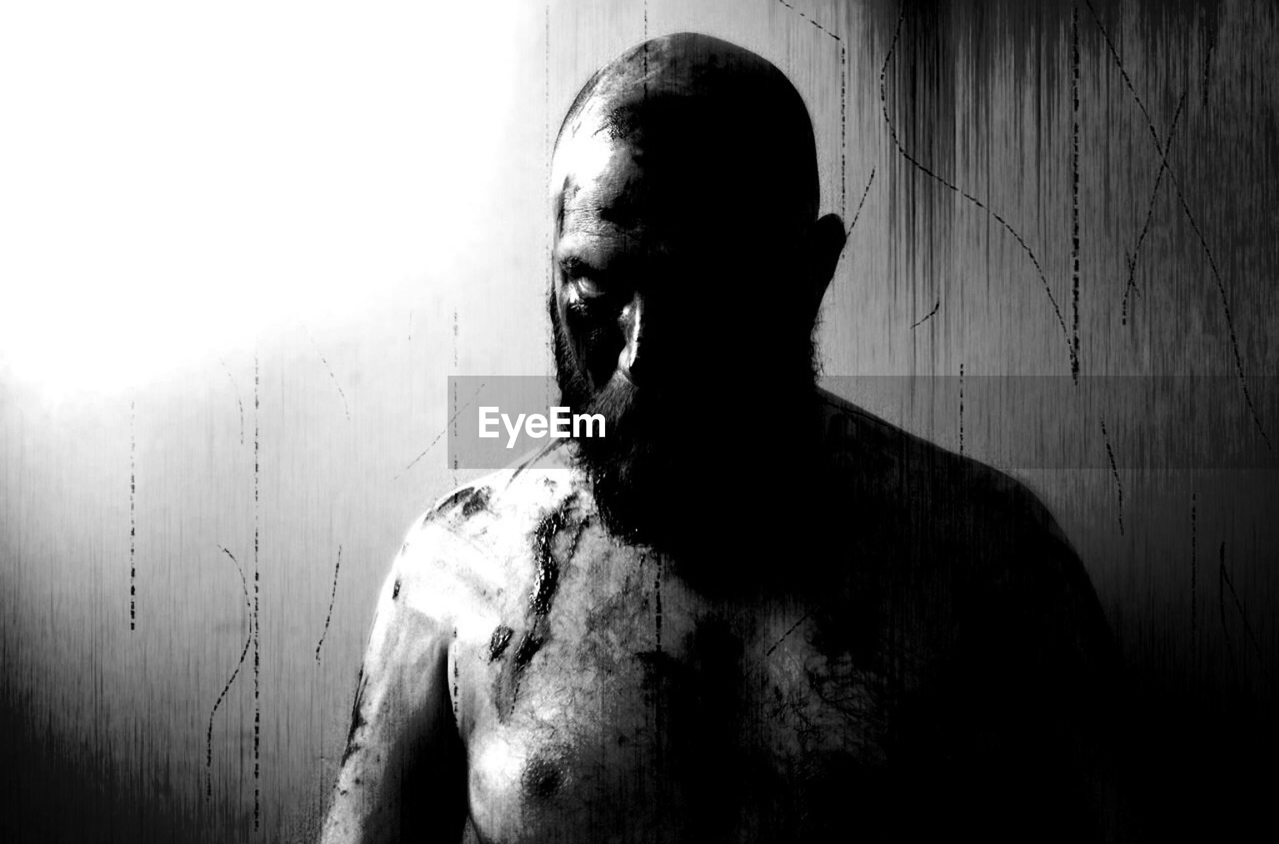 Portrait of spooky shirtless man