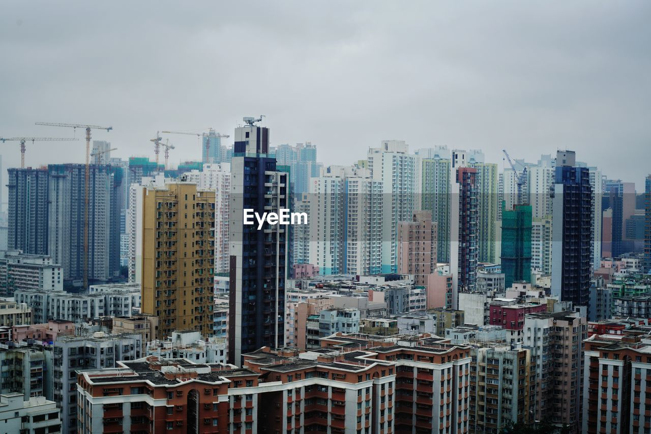 building exterior, city, built structure, architecture, building, sky, cityscape, tall - high, residential district, skyscraper, cloud - sky, office building exterior, crowd, nature, urban skyline, crowded, modern, tower, day, financial district, apartment, settlement