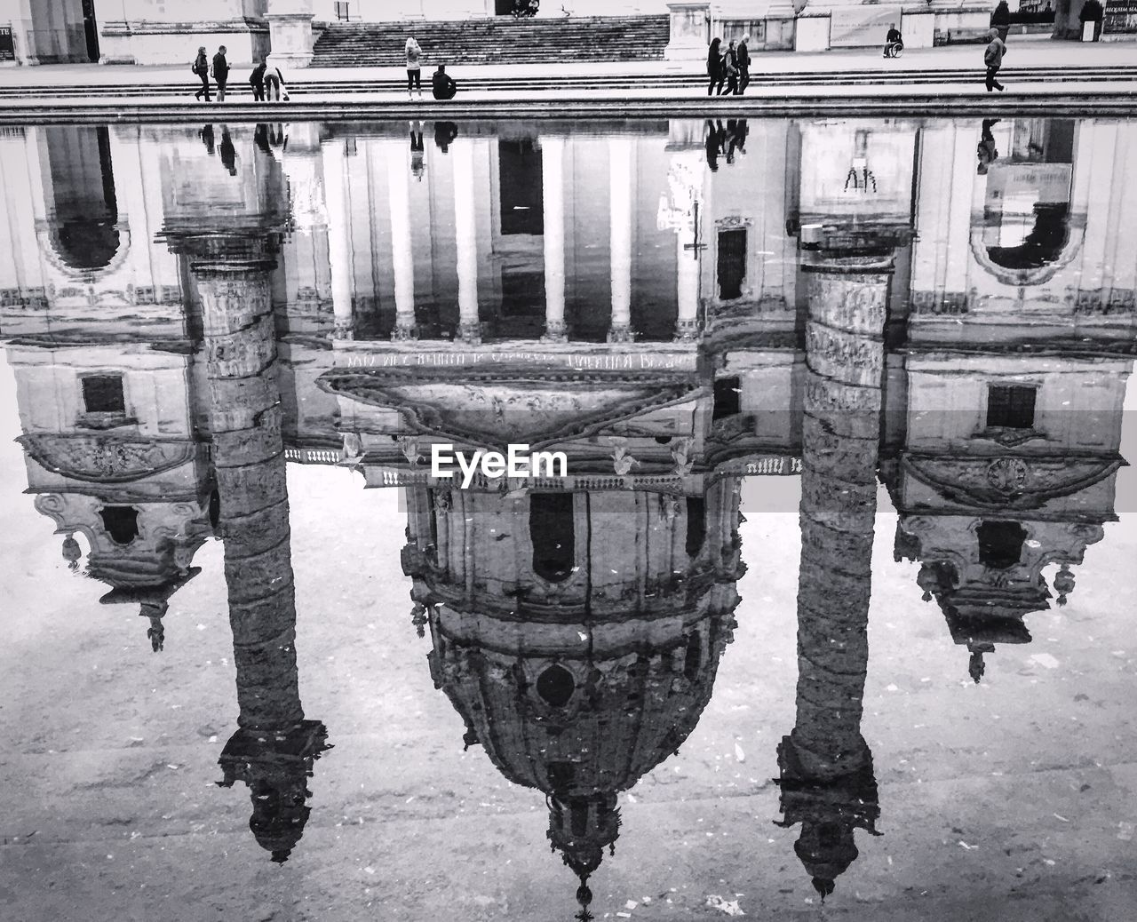 Reflection of basilica in water