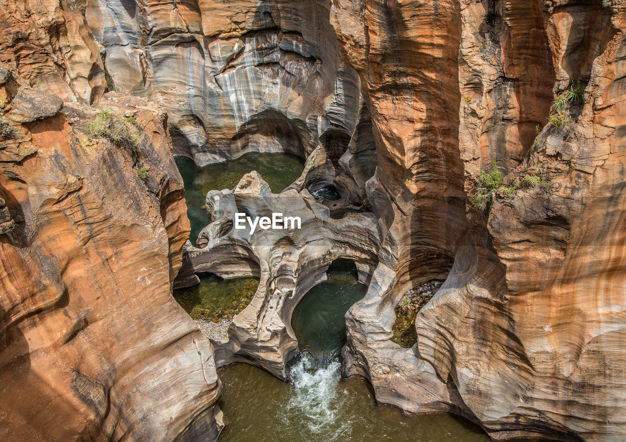 rock, rock formation, rock - object, solid, geology, day, nature, beauty in nature, no people, natural pattern, textured, physical geography, rough, non-urban scene, travel destinations, water, eroded, outdoors, tranquility, formation