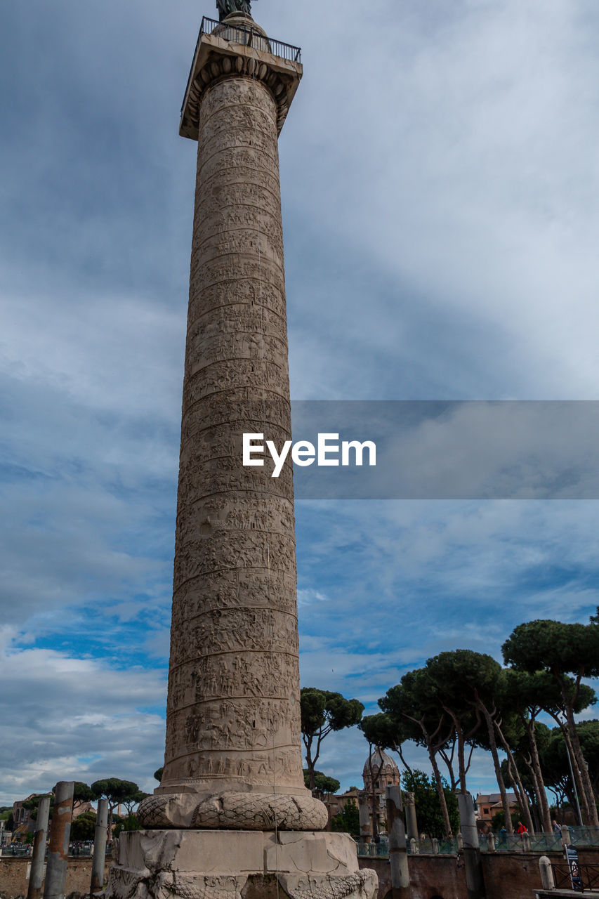 sky, architecture, low angle view, architectural column, built structure, cloud - sky, history, nature, the past, day, building exterior, travel destinations, no people, tall - high, tree, outdoors, travel, tourism, plant, ancient, ancient civilization, ruined