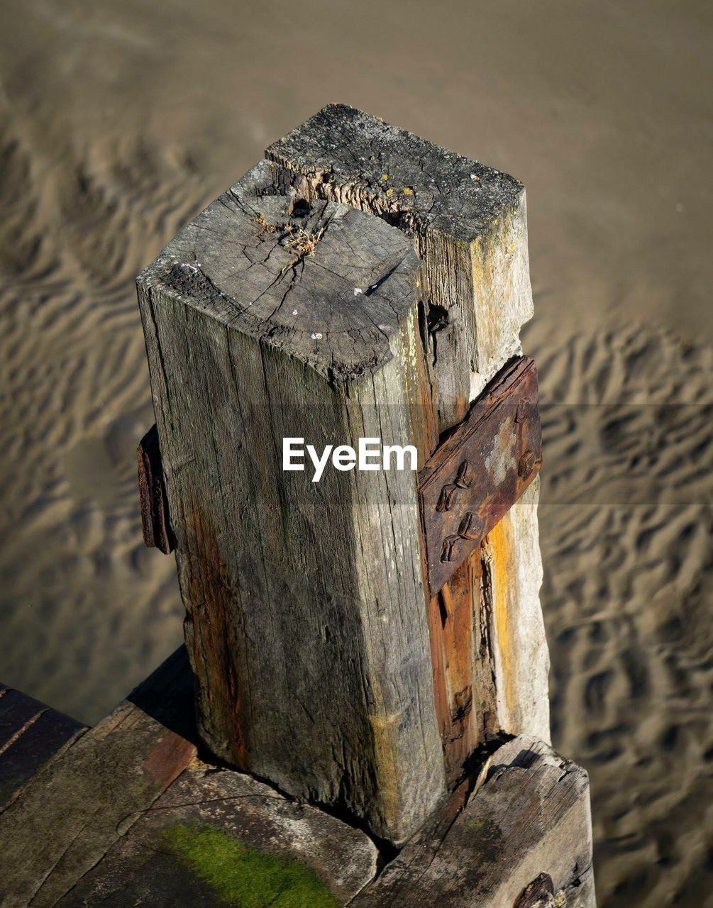 High angle view of wooden post at beach