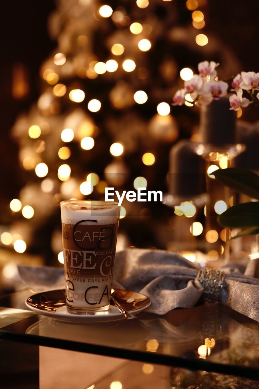 illuminated, drink, refreshment, table, focus on foreground, food and drink, cup, night, indoors, candle, mug, celebration, close-up, coffee cup, coffee - drink, flame, lighting equipment, no people, burning