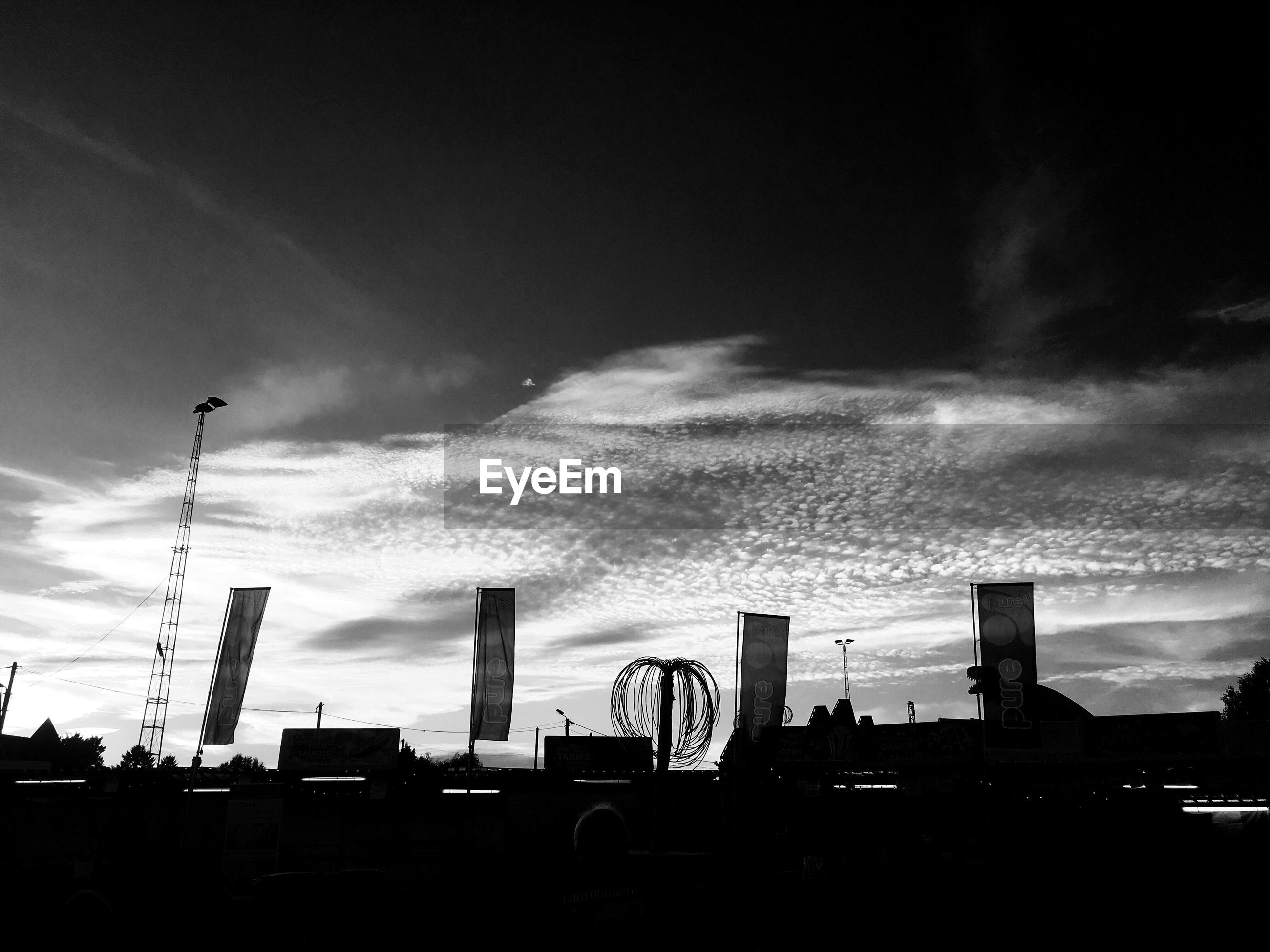 built structure, sky, architecture, cloud - sky, transportation, building exterior, silhouette, no people, low angle view, car, outdoors, city, day