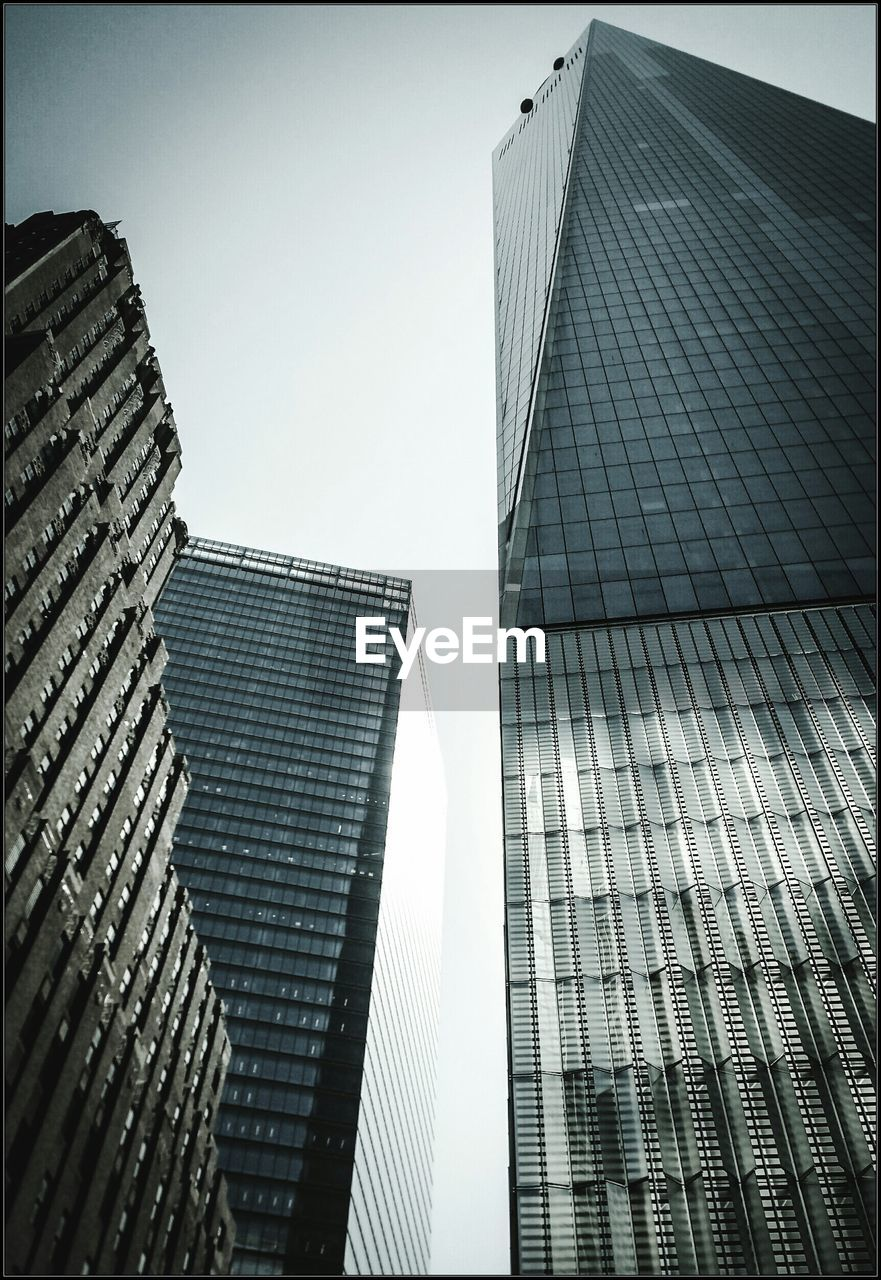architecture, building exterior, skyscraper, built structure, modern, low angle view, city, tall, outdoors, day, clear sky, no people, corporate business, growth, twin, sky, office park