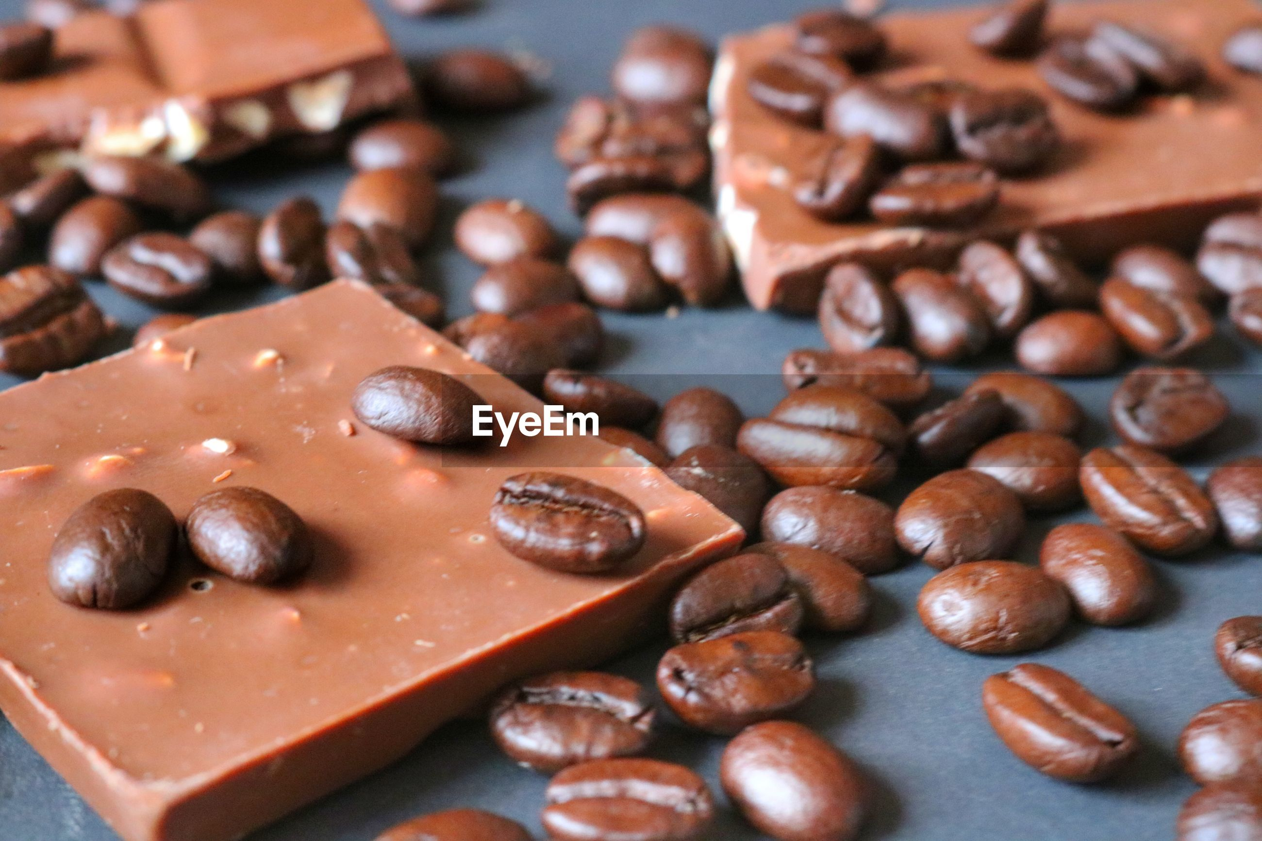 Close-up of coffee beans and chocolates on table