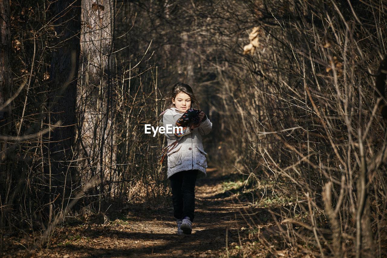 Cute Girl Walking On Footpath In Forest