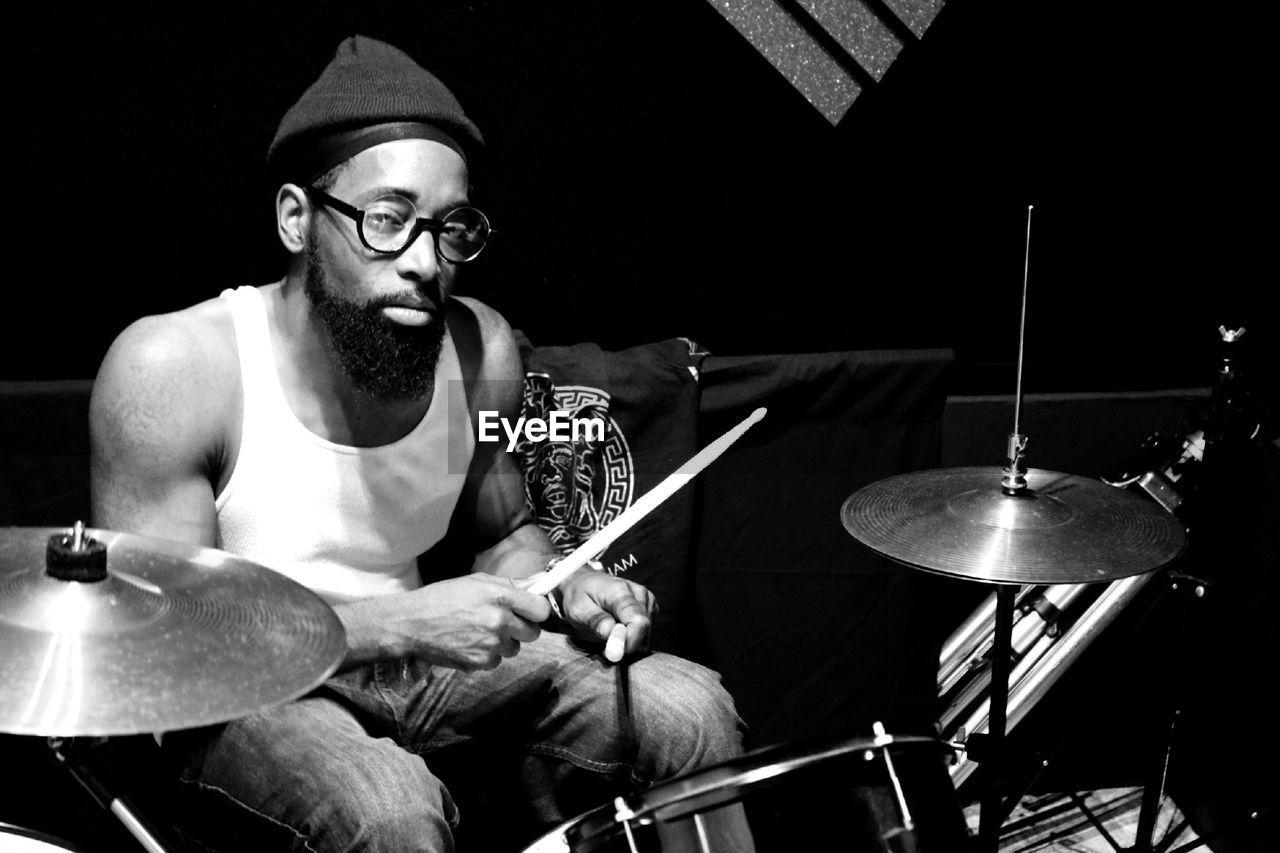 Portrait of drummer at concert