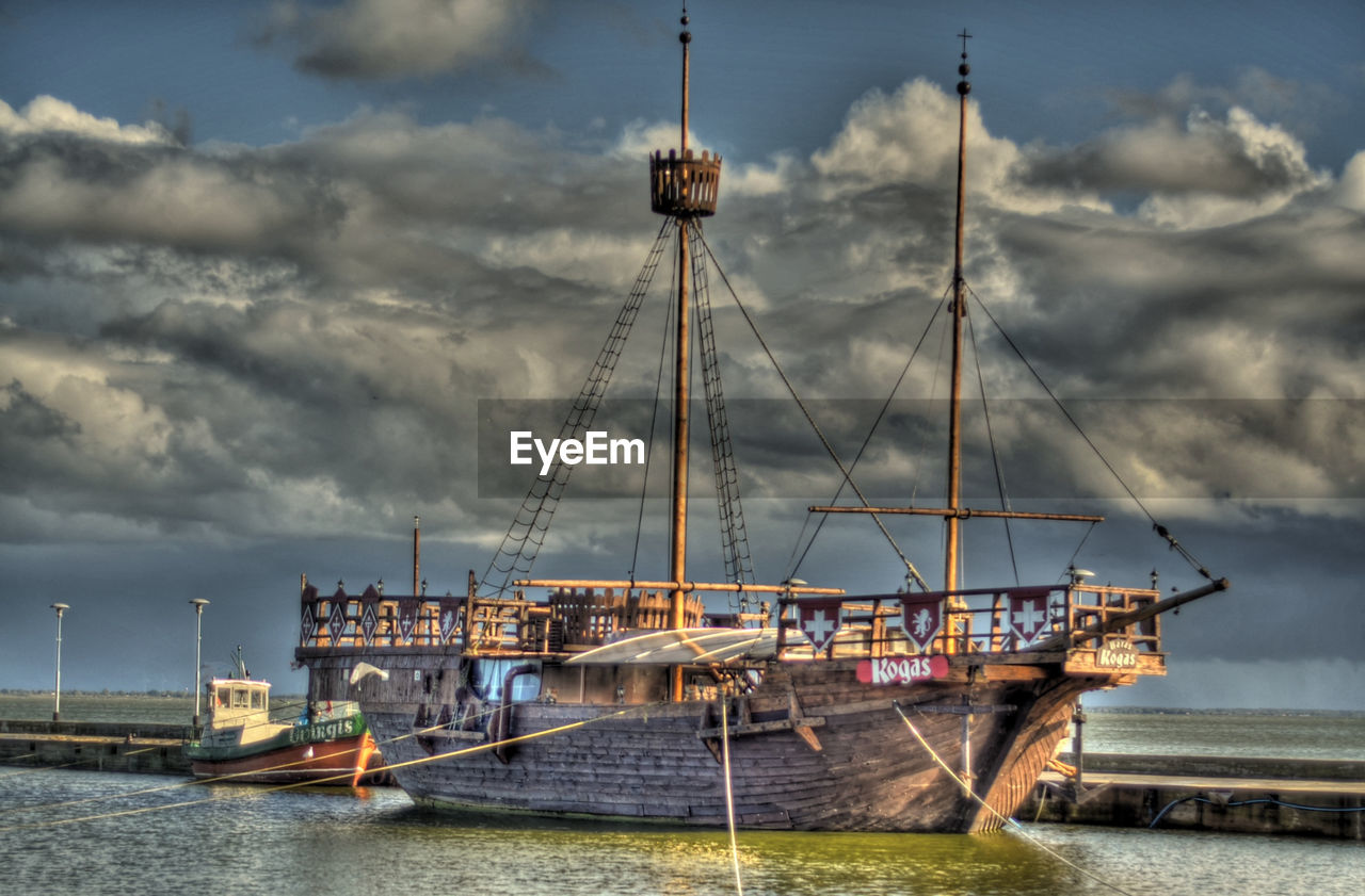 nautical vessel, transportation, water, sky, cloud - sky, waterfront, mode of transport, no people, sea, outdoors, moored, day, nature, architecture, mast, beauty in nature, sailing ship