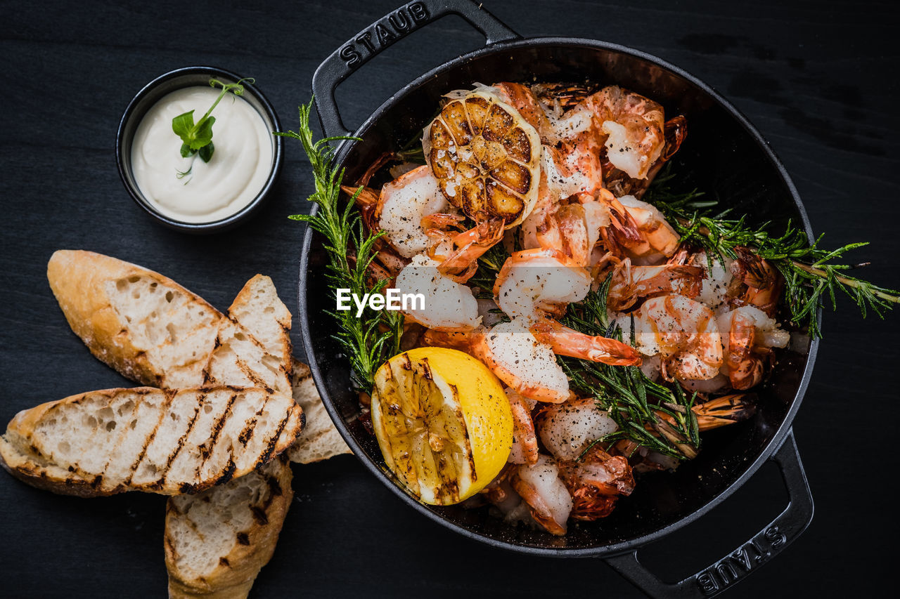 food and drink, food, meat, freshness, kitchen utensil, healthy eating, ready-to-eat, directly above, seafood, crustacean, indoors, no people, wellbeing, bread, barbecue, household equipment, vegetable, high angle view, still life, prawn, herb