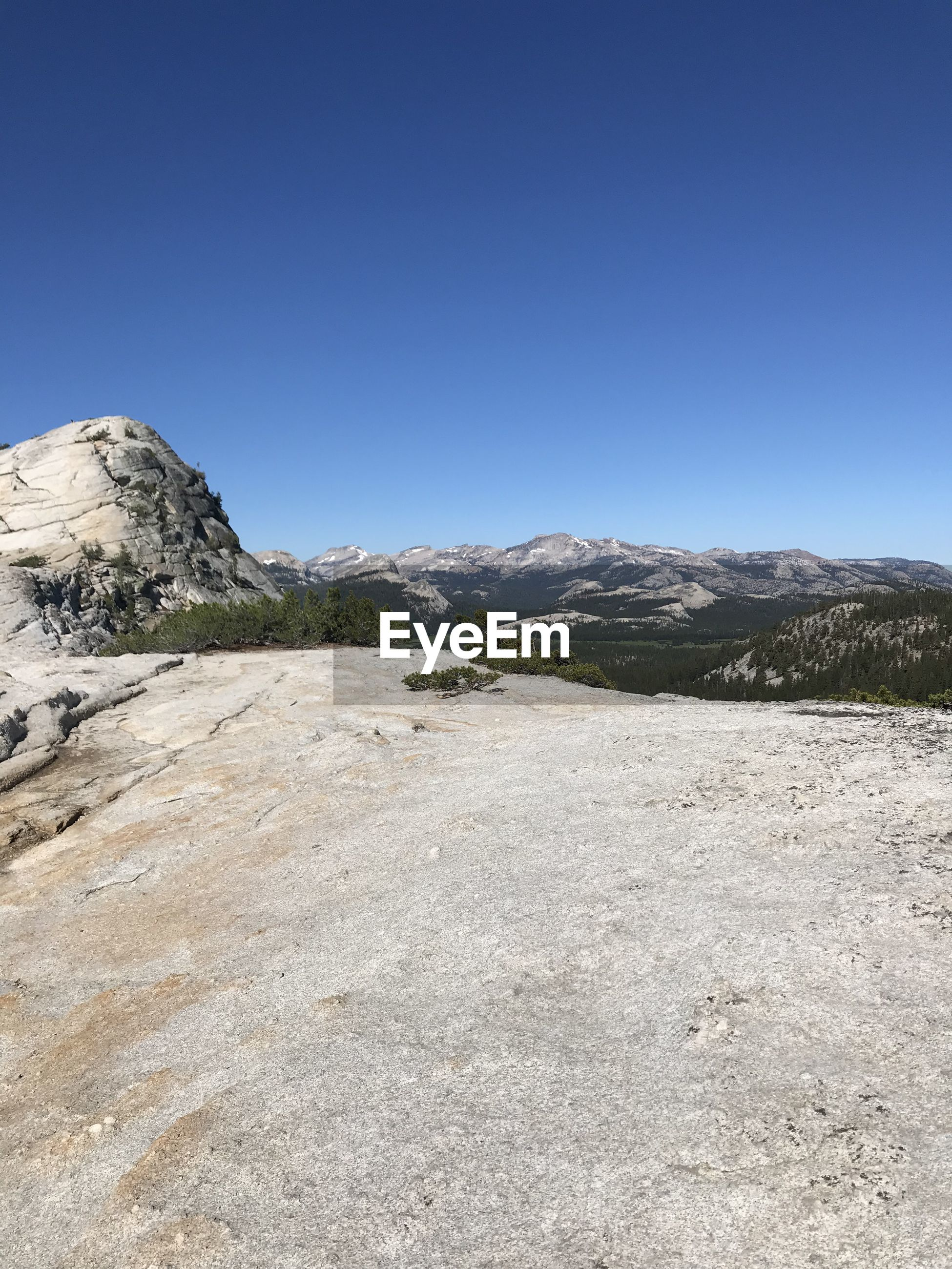Scenic view of rocky mountains against clear blue sky