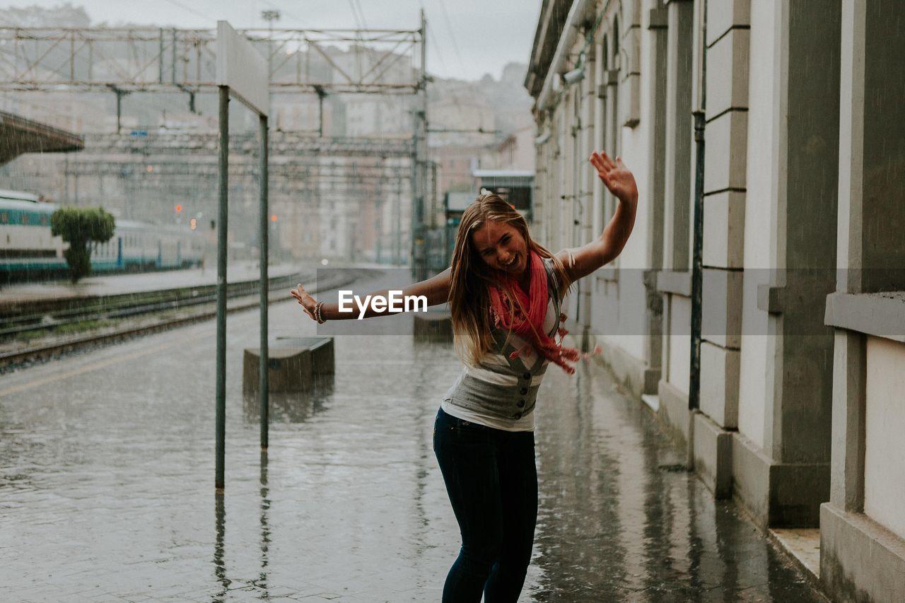woman dancing in rain