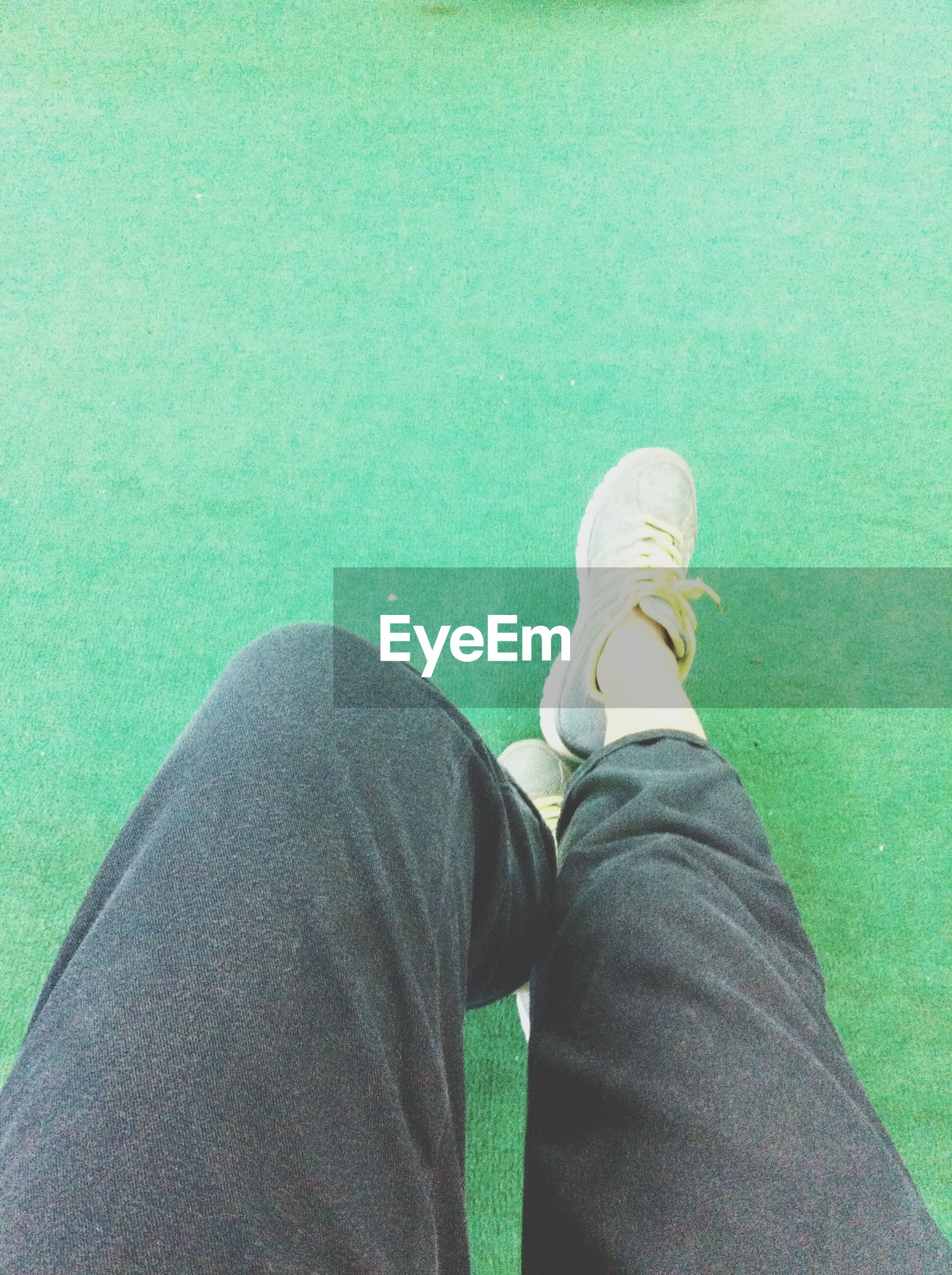 lifestyles, indoors, copy space, low section, leisure activity, men, person, casual clothing, part of, green color, shoe, personal perspective, high angle view, close-up, blue