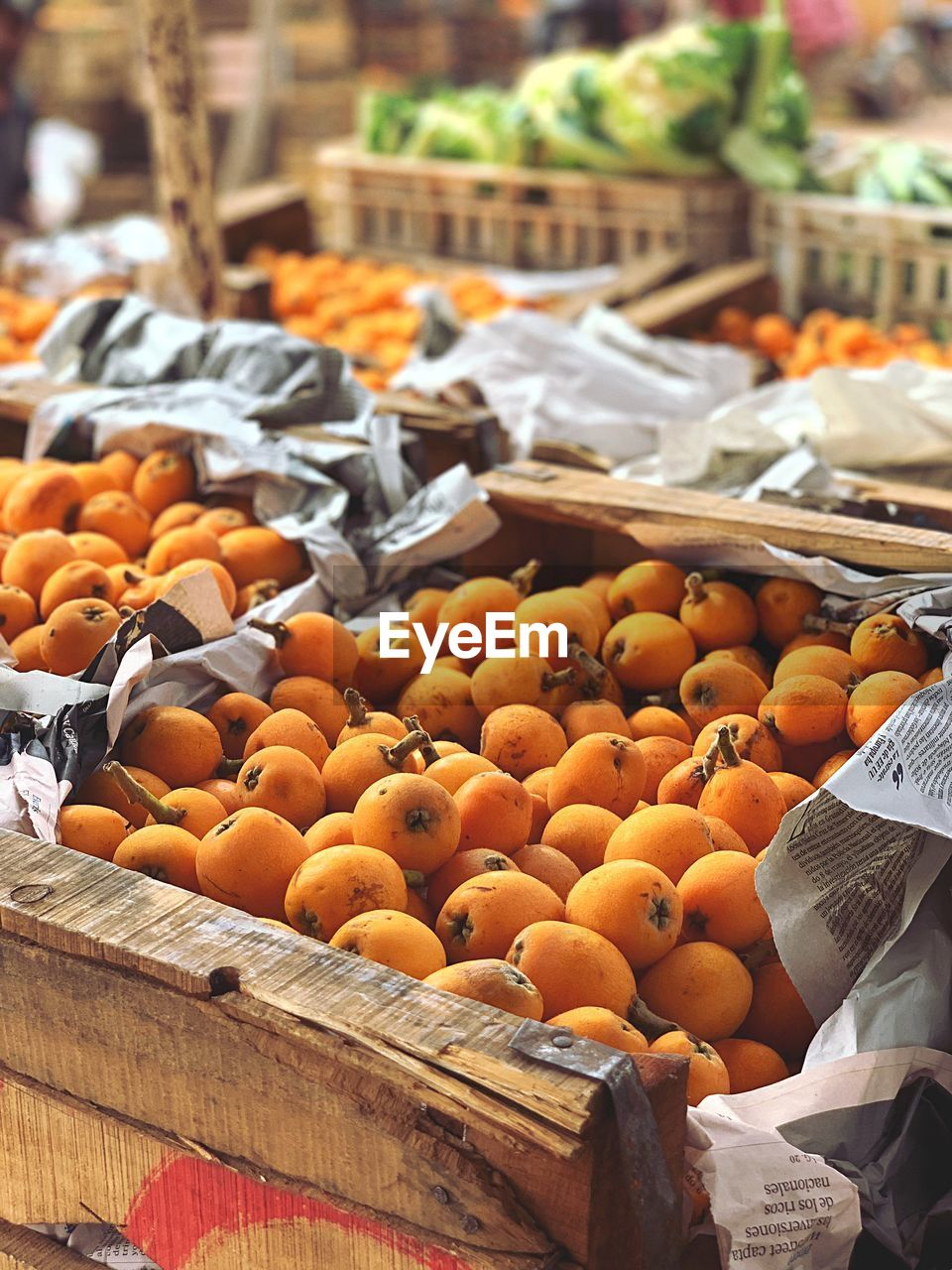 food and drink, food, orange color, healthy eating, large group of objects, for sale, market, freshness, fruit, market stall, abundance, container, retail, no people, day, vegetable, wellbeing, sale, focus on foreground, sunlight, outdoors, orange, retail display