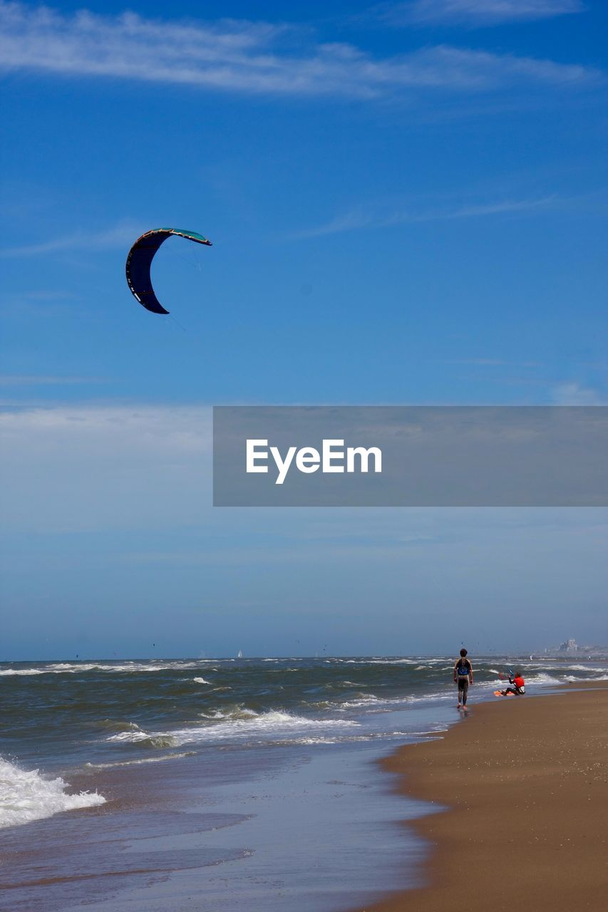 water, sea, horizon over water, sky, beach, horizon, land, beauty in nature, sport, real people, leisure activity, adventure, extreme sports, aquatic sport, scenics - nature, lifestyles, nature, surfing, motion, kiteboarding, outdoors