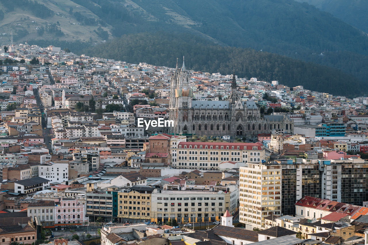 High Angle View Of Townscape Against Mountains