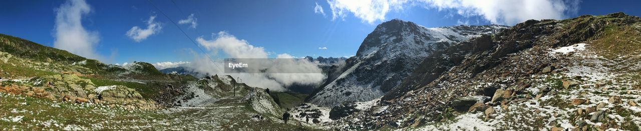 mountain, scenics - nature, beauty in nature, sky, tranquil scene, cloud - sky, tranquility, panoramic, mountain range, non-urban scene, nature, landscape, day, rock, environment, no people, idyllic, rock - object, solid, sunlight, outdoors, mountain peak, formation, snowcapped mountain