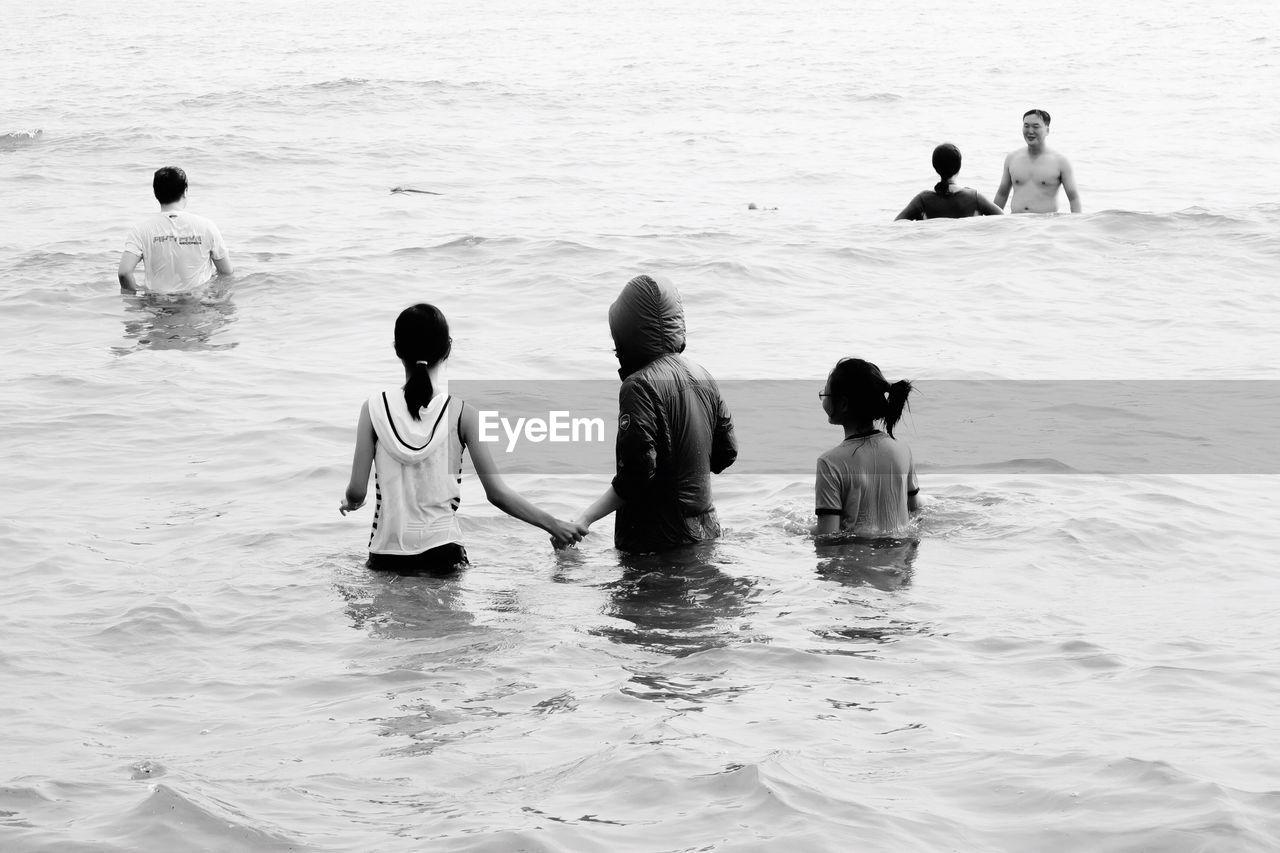 FRIENDS ENJOYING IN SEA