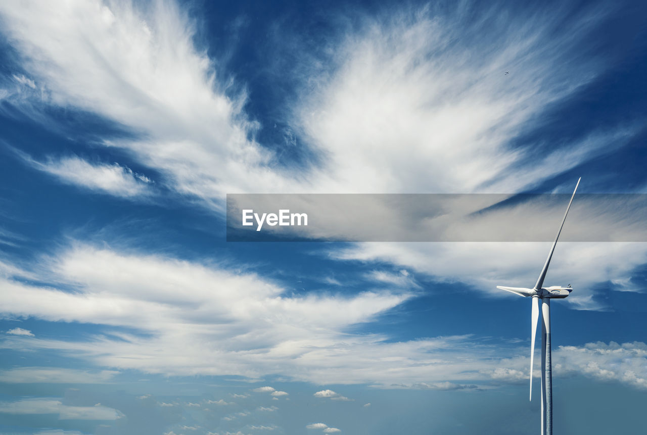 cloud - sky, sky, low angle view, fuel and power generation, nature, no people, beauty in nature, environmental conservation, environment, renewable energy, alternative energy, scenics - nature, technology, outdoors, turbine, wind turbine, electricity, day, tranquility, blue, power supply, power in nature, sustainable resources