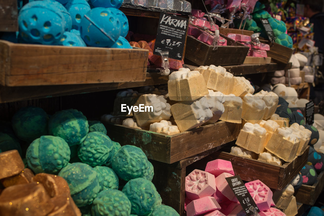 retail, large group of objects, food, for sale, food and drink, choice, market, variation, multi colored, abundance, market stall, no people, still life, freshness, small business, business, store, stack, day, sweet food, retail display, sale, temptation, variety