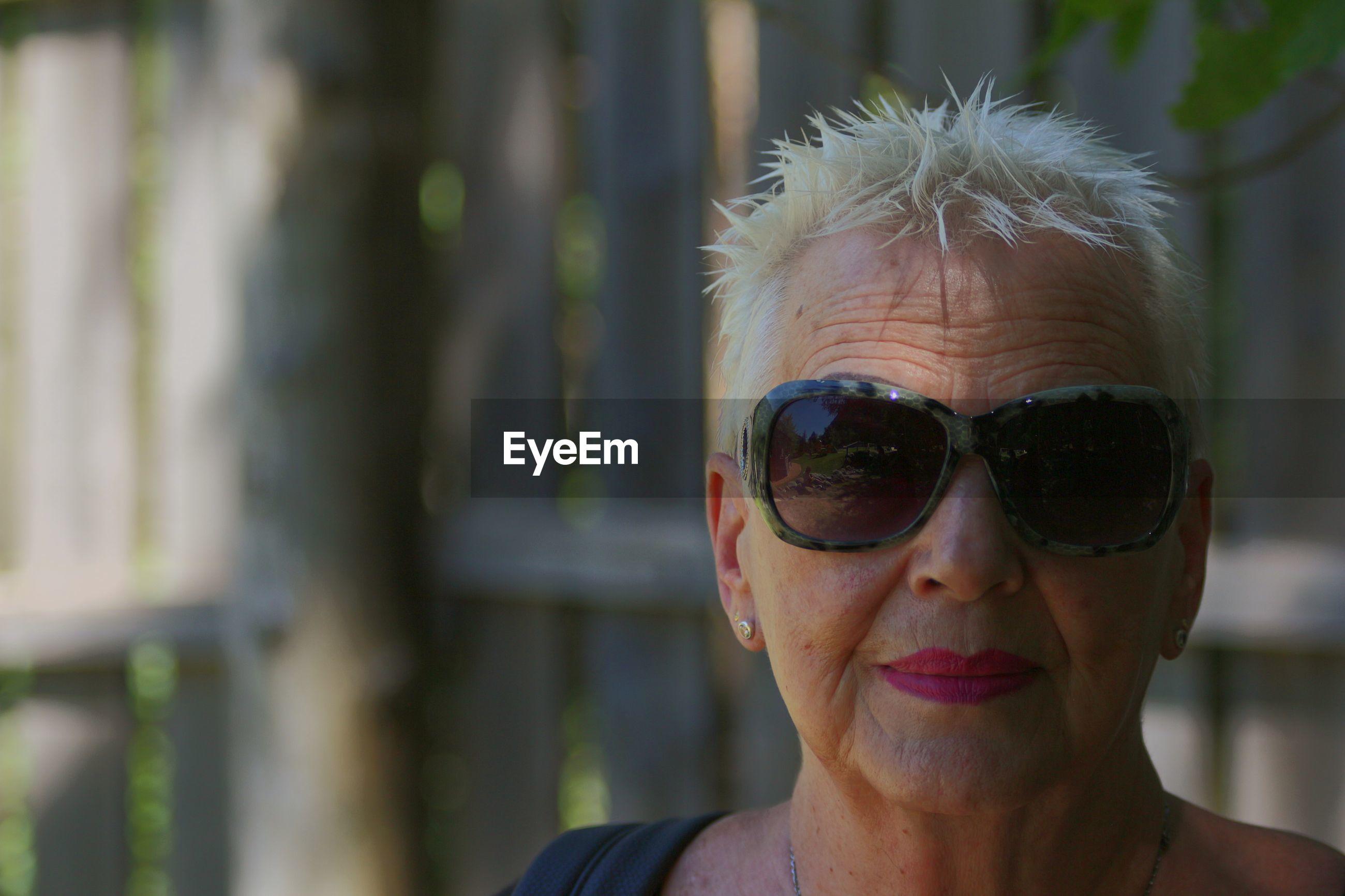 Blond grandmother portrait portrait of woman wearing sunglasses