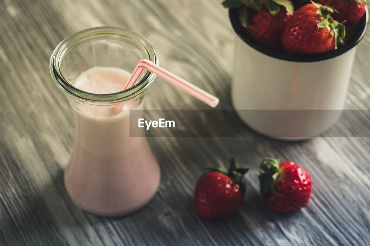 food and drink, food, fruit, table, healthy eating, drink, freshness, berry fruit, refreshment, wellbeing, still life, red, strawberry, glass, no people, drinking glass, close-up, indoors, glass - material, milk, breakfast
