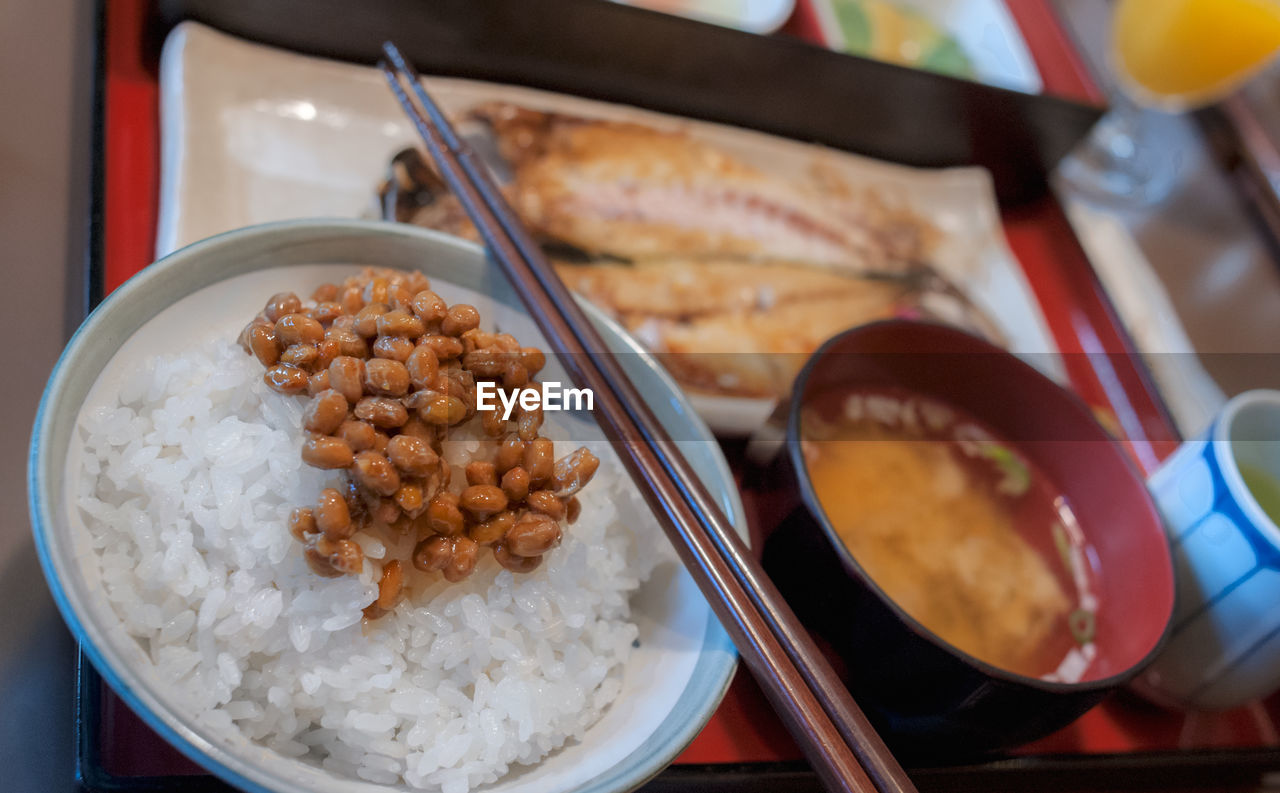 High angle view of typical japanese breakfast with natto served on table