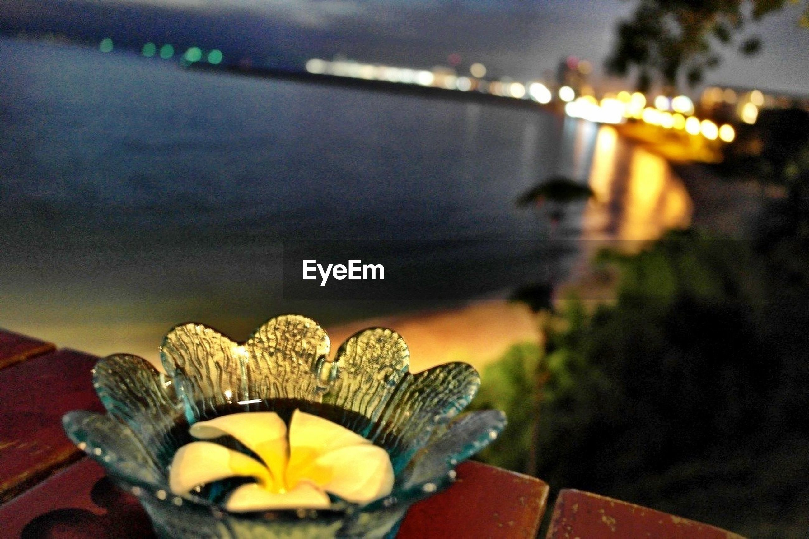 focus on foreground, illuminated, close-up, sky, decoration, sunset, lighting equipment, night, outdoors, no people, dusk, orange color, low angle view, selective focus, sunlight, yellow, lens flare, nature, pattern, tradition