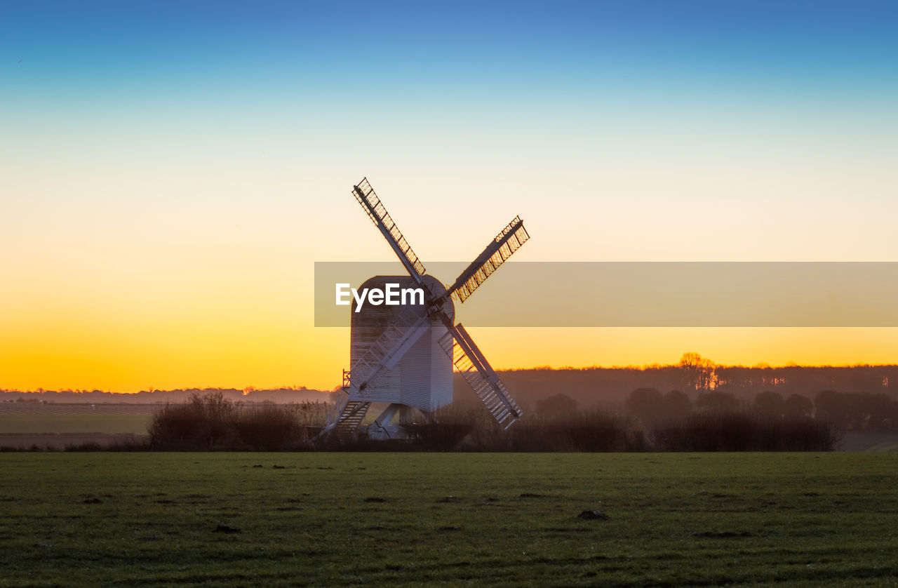 sky, renewable energy, alternative energy, environmental conservation, environment, fuel and power generation, wind turbine, turbine, wind power, sunset, landscape, traditional windmill, nature, field, land, architecture, built structure, rural scene, no people, orange color, outdoors