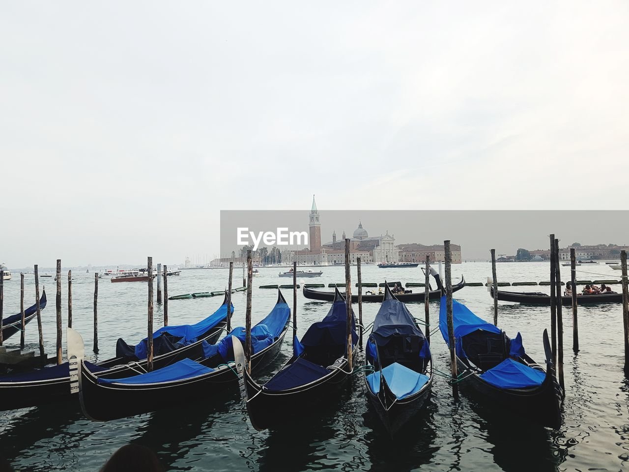 nautical vessel, water, building exterior, architecture, transportation, built structure, travel destinations, mode of transportation, sky, moored, travel, place of worship, gondola - traditional boat, tourism, nature, religion, city, day, belief, canal, post, no people, wooden post, outdoors
