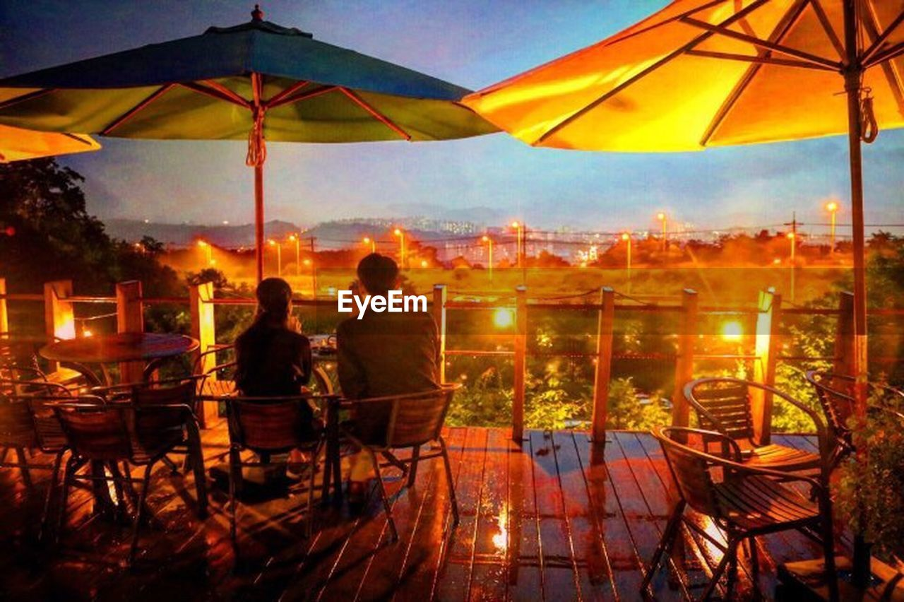 table, chair, restaurant, canopy, relaxation, cafe, sitting, summer, night, people, vacations, sunset, adults only, outdoors, illuminated, nature, friendship, adult, food, only men