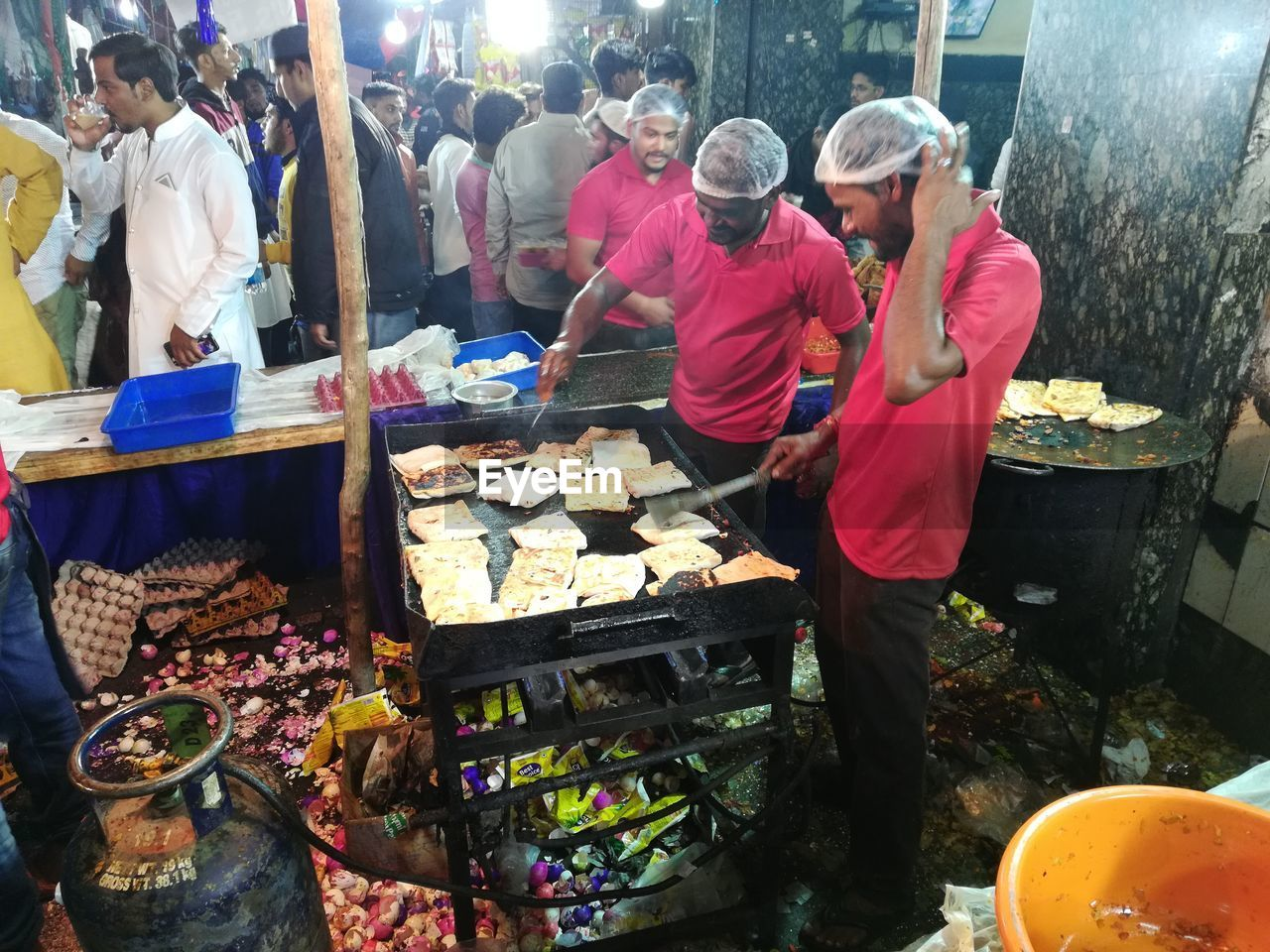 men, market, real people, food, food and drink, group of people, occupation, retail, market stall, people, preparing food, standing, preparation, adult, casual clothing, choice, day, women, meat, selling, outdoors, buying