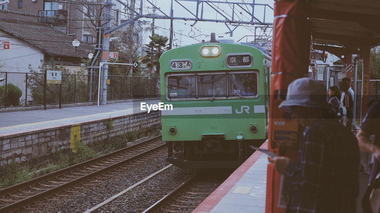 TRAIN IN RAILROAD STATION PLATFORM
