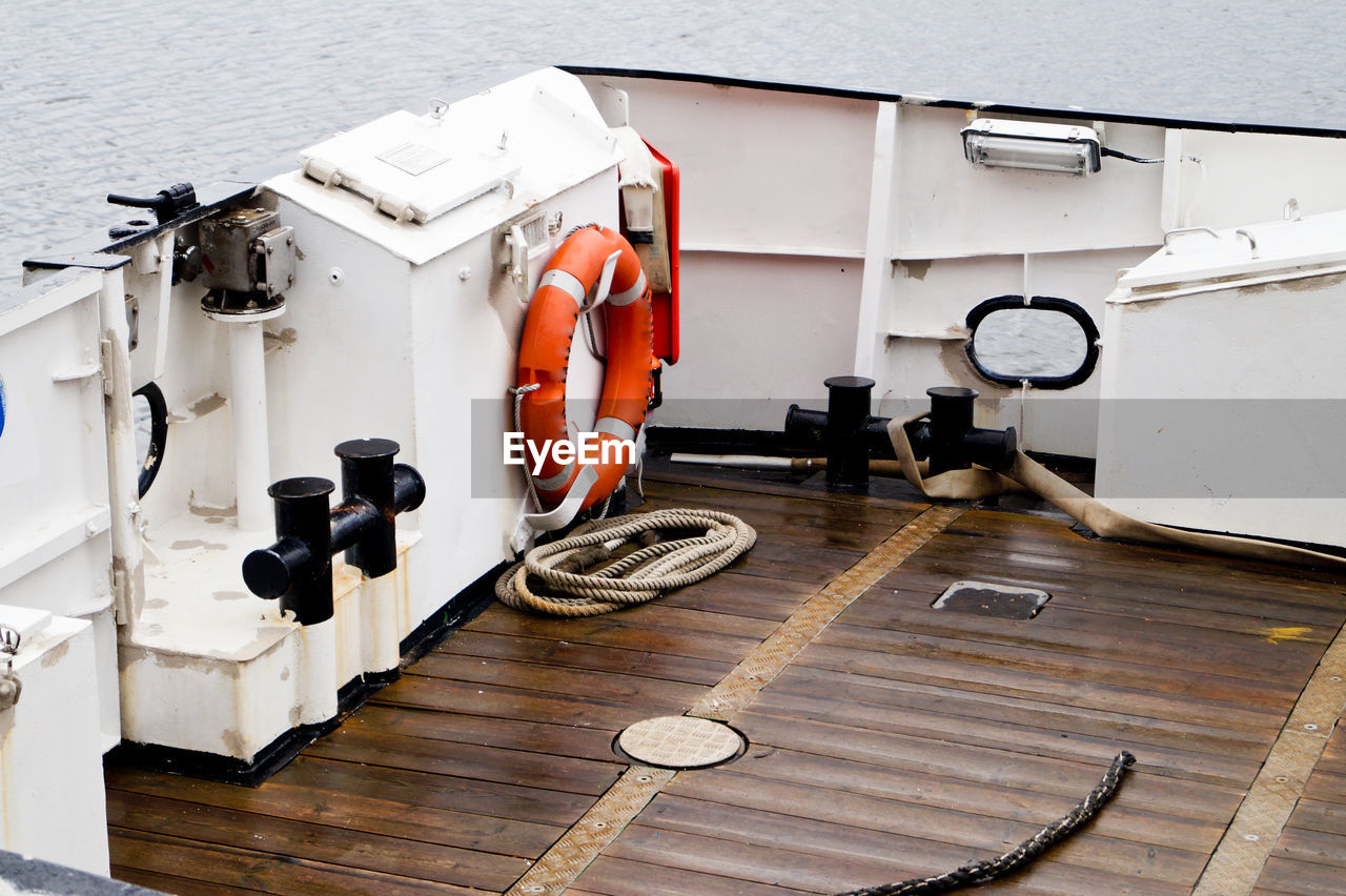 High angle view of lifebelt on boat at sea