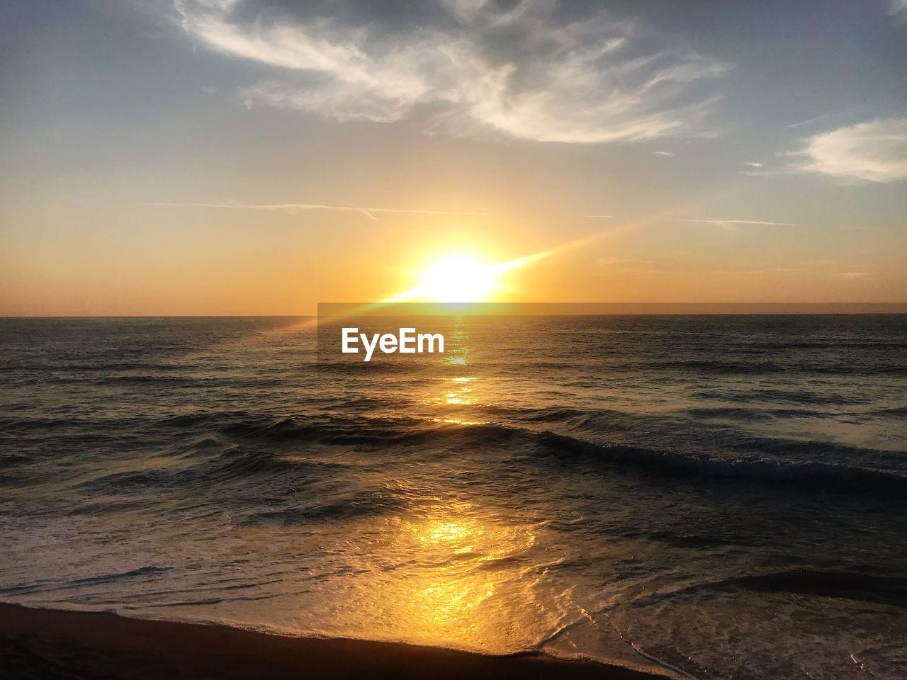 sky, sea, water, sunset, beauty in nature, scenics - nature, horizon, horizon over water, tranquility, beach, land, sun, cloud - sky, tranquil scene, idyllic, sunlight, nature, wave, non-urban scene, outdoors, no people