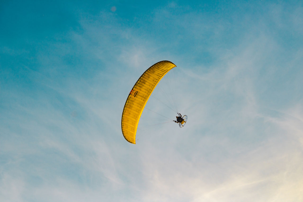 LOW ANGLE VIEW OF PARAGLIDING IN SKY