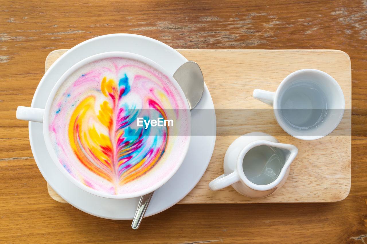Multi colored cappuccino on table