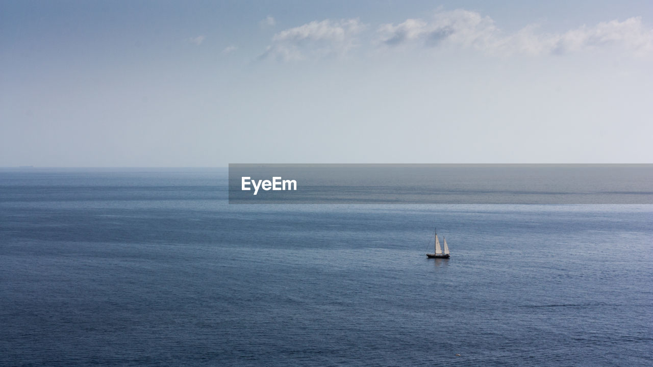 sea, water, horizon over water, sky, horizon, nautical vessel, beauty in nature, scenics - nature, transportation, tranquil scene, waterfront, tranquility, mode of transportation, sailing, nature, no people, sailboat, day, non-urban scene, yacht