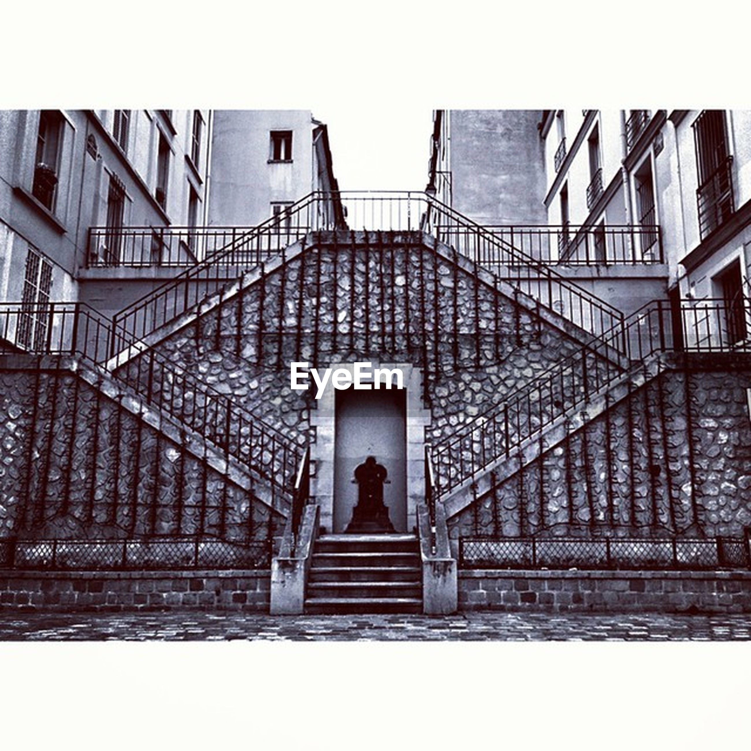 architecture, built structure, steps, steps and staircases, low angle view, staircase, building exterior, railing, stairs, building, rear view, indoors, full length, arch, day, standing, men, walking