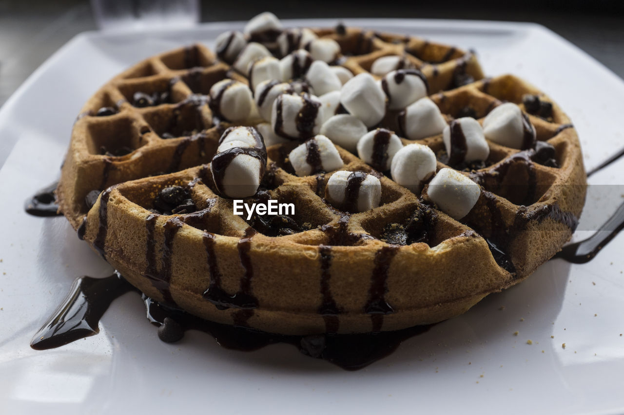 Close-up of waffle with marshmallows served in plate