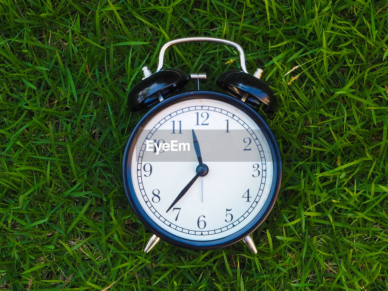 time, clock, alarm clock, grass, plant, number, field, accuracy, instrument of time, day, no people, nature, clock face, green color, minute hand, close-up, land, growth, communication, single object, hour hand