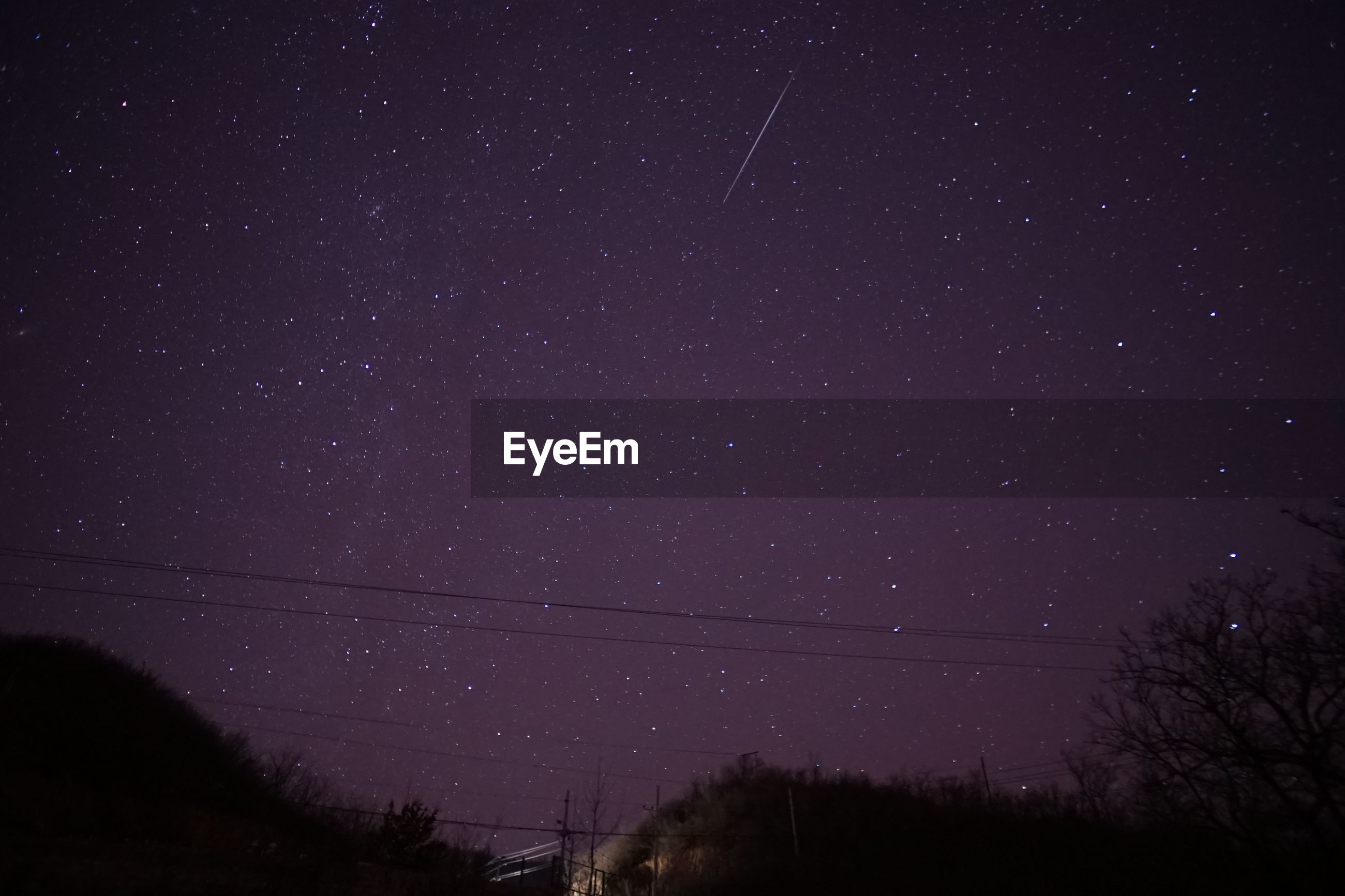 Low angle view of illuminated constellation in sky at night