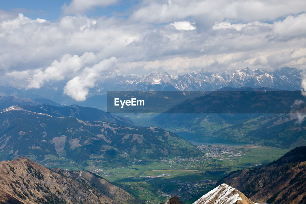 Scenic View Of Mountains Against Cloudy Sky During Sunny Day