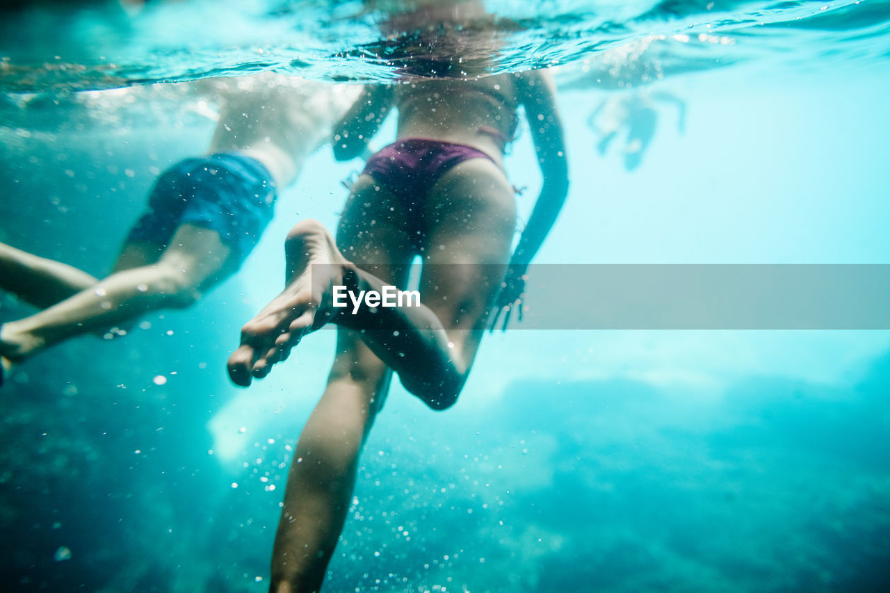 Close-Up Of People Swimming In Sea